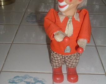 vintage wind up clown toy