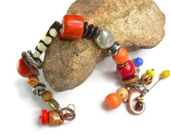 Bold Boho Style Mixed Orane Bead & Material Bracelet With A Tribal Vibe