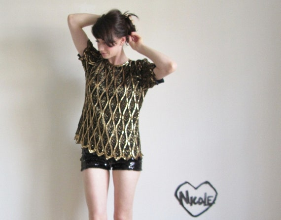 gold sequin top . razzle dazzle to the max .medium .sale