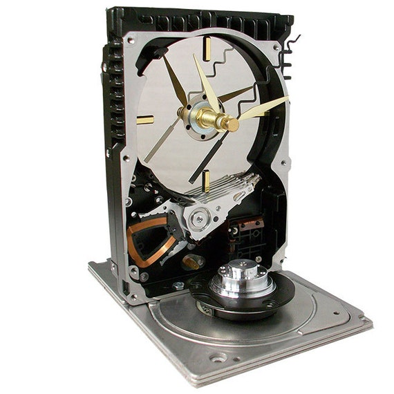 Unique Hard Drive Clock Accented with a Motor Spindle and Special Zigzag Hand.