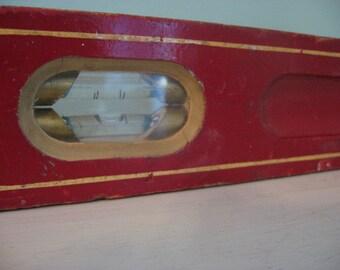 red vintage wood level
