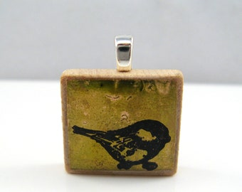 Olive green bird - Glowing metallic Scrabble tile pendant