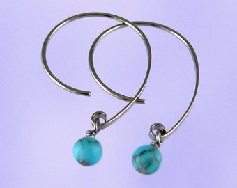 Niobium earrings: Blue turquoise beads on Apostrophe earwires
