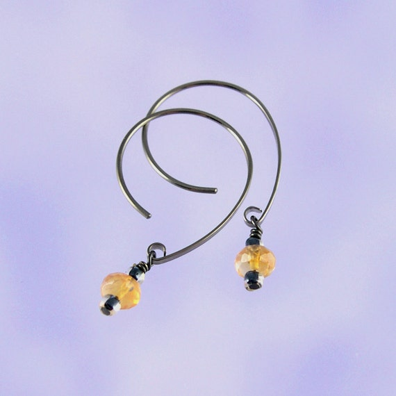 Niobium earrings: Faceted fire opal 6mm beads on Apostrophe earwires (opal2)