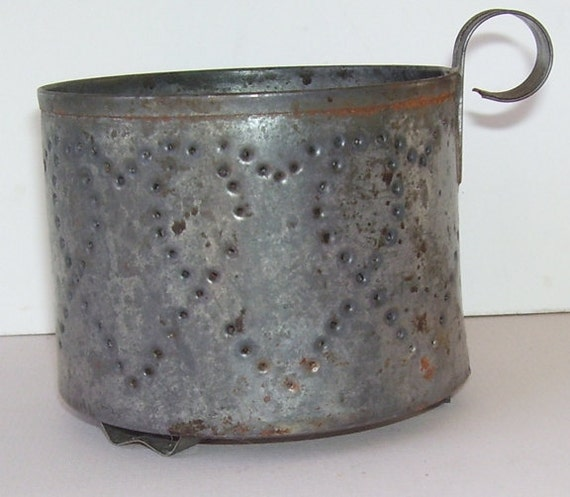 Antique round metal footed candle holder with handle punched - Punched metal candle holder ...