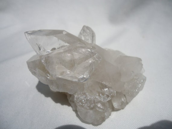 Clear Quartz Cluster with Internal Pyramids and Rainbows