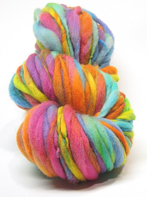 Super bulky handspun rainbow yarn, spun thick and thin in merino wool- 72 yards, 3.0 ounces/ 85 grams