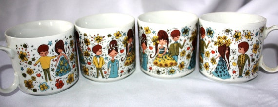 Set of 4 vintage coffee cups - man and woman through the years -floral