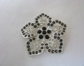 Delightful vintage silver tone filigree flower pin brooch with black stone accents