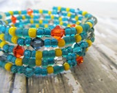 Beaded memory wire bracelet, coil bracelet with Swarovski crystals and seed beads