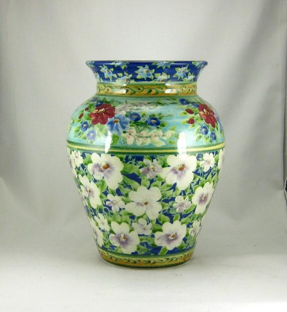 Large blue handmade porcelain vase with white flowers