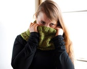 Knitted circle scarf in pistachio green. Hand knit soft and vegan friendly neck warmer scarf for autumn