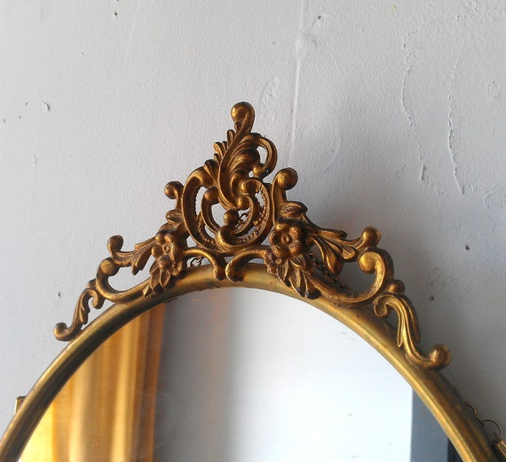 Antique Oval Mirror In Ornate Brass Frame 19 By 12 Inches