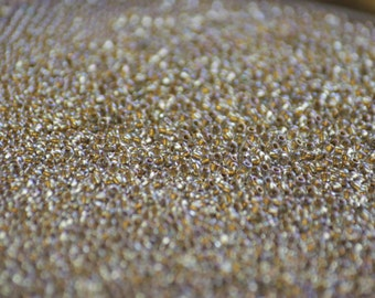 10 grams of 11/0 sized Inside Color Crystal / Gold Lined TOHO seed beads (TH129)