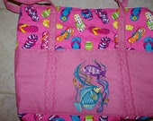 flip flop bag with embroidered fish on pocket.