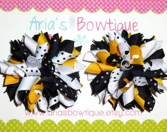 A Pair Of Sophisticated Pair Of Yellow, White And Black Mini Korker Hair Bows