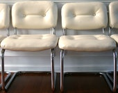 Pair Vintage White Leather Chairs. Chrome Chairs. Dining Chairs. Tufted. Tubular. Dudes. Men Centric. Minimalist.