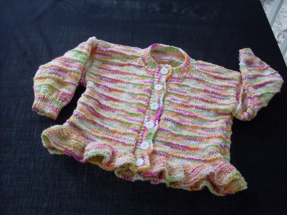 Hand knit girl's variegated peplum cardigan