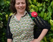 Crochet pattern: lace shrug with a rose