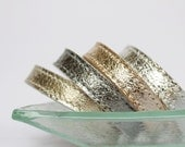 Set   Of Four  Shiny Leather Bracelets