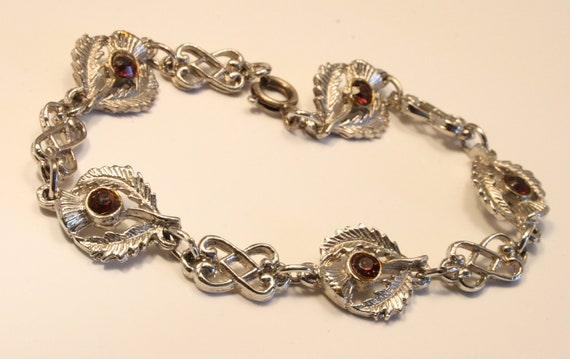 Vintage thistle bracelet with purple rhinestones.