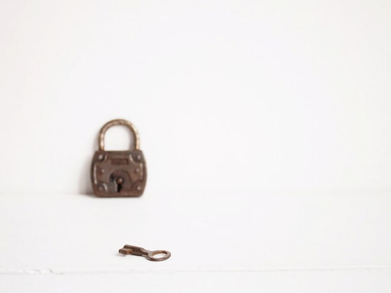 Vintage padlock with key, An old rusted lock