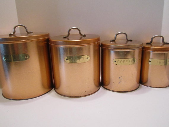 Copper and Aluminum Canister Eight Piece Set with Brass Labels and Brass Handles