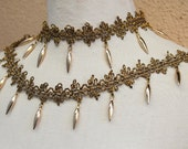 Very nice embroidered gold color  trim  with  hanging beats 1 yard listing 2 inch wide