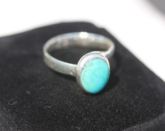 Beautiful Turquoise Ring set in Fine Silver   Size 8.5