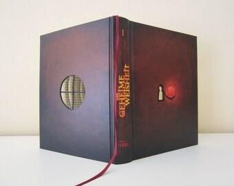 Book Art: The secret Wisdom - Book sculpture No. 48