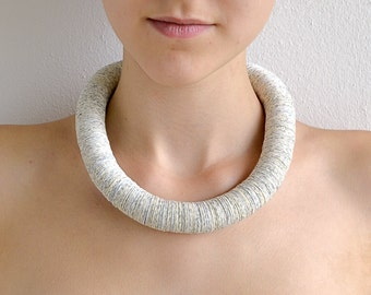 Necklace made of small circles of Book pages