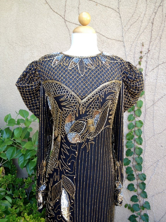 A vintage 1970s 1980s black and gold sequined beaded silk puffed up sleeves cocktail party theme wedding dress size S