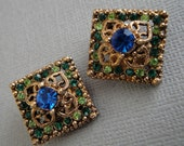 Vintage Rhinestone Earrings in Blue and Emerald and Peridot Green with gold filligree and clip on backs very unique square design