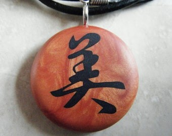 Japanese kanji BEAUTY symbol hand carved on a polymer clay copper pearl color background. Pendant comes with a FREE necklace