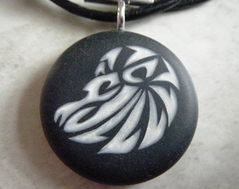 Zodiac LEO  hand carved on a polymer clay black color background. Pendant comes with a FREE 3mm necklace