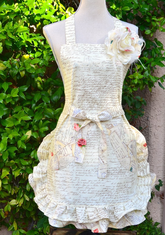 Paris Print Apron With Floral Ruffle And Rose Pin