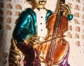 Vintage Costume Jewelry signed ELLE brooch - A man playing the Cello