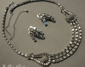 Vintage Wedding Necklace with Baguette Rhinestones and a very unusual design in silver tone and clear stones paired with clip Earrings
