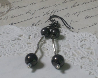 Gunmetal Grey Modern Elegance Earrings - Gunmetal Beads And Silver Swirly Tubes Suspended From Gunmetal French Hook Wires