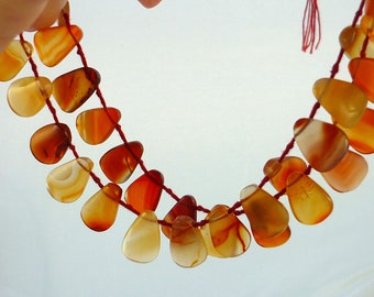 SALE......Carnelian smooth polished shoehorn briolette beads 18-19mm 1/2 strand