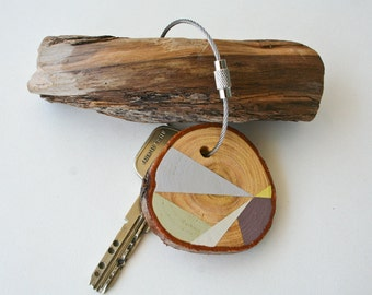 Pine wood keychain with stainless steel cable wire, tones of pale brown, brown, olive and yellow geometric triangle shapes keyring