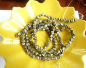 1/2 strand Pyrite, golden, rough, small  Nugget beads ,(4-7mm)