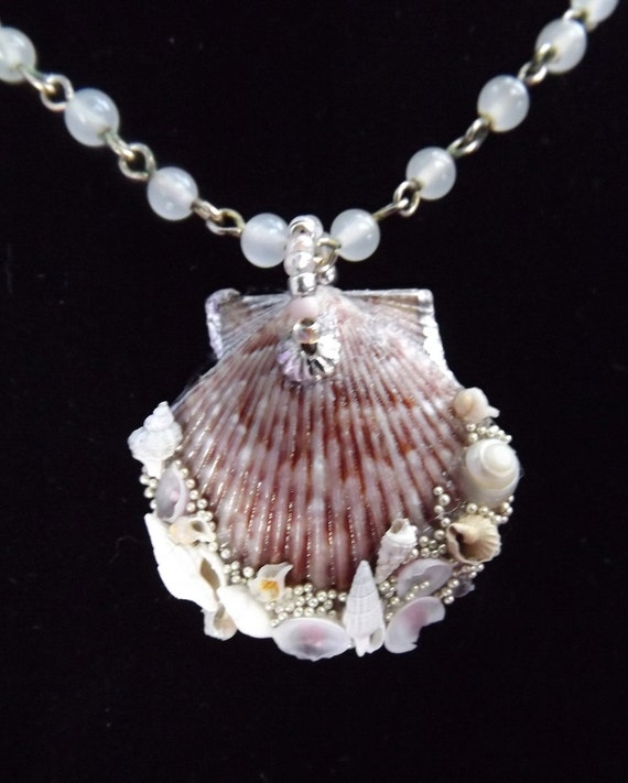 "Sea Shell Necklace, Titled, ""The SEEKER of the OVERLOOKED"", created with a scallop shell found on Sanibel Island and tiny shells"