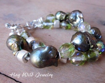 Multi strand green baroque pearls and crystal bracelet