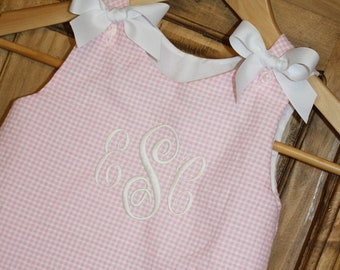 Baby girl bubble in pink gingham seersucker with white bows and monogram