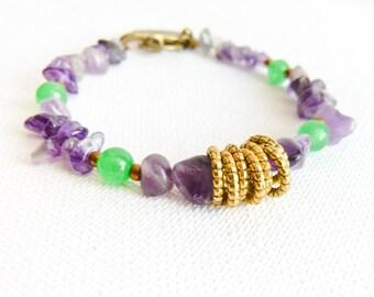 Nature inspired Amethyst peridot charm bracelet.  Bird charm. 7 golden lucky ring. Birthstone jewelry