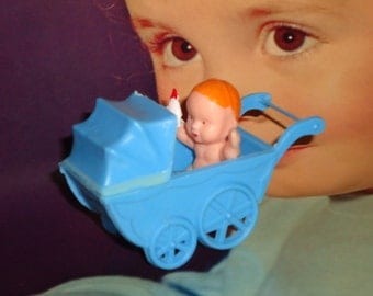 Retro Small Plastic Baby Buggie with Baby