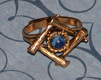 Retro Adjustable Costume Jewelry Ring Gold Colored Metal with Blue Stone