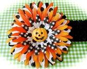 Halloween pumpkin polka dot 4 inch flower on alligator clip removable from 1.5 or 3 inch crochet headband
