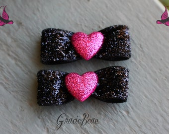 Black Glittery Bow Hair Clips With Sparkling Pink Hearts-Set Of 2
